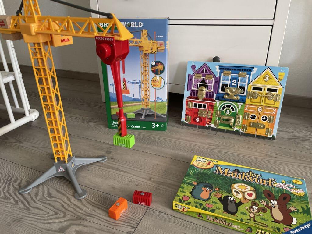 Spielzeug leihen Kran, Maulwurf Haba Spiel und Melissa Doug Activity Board